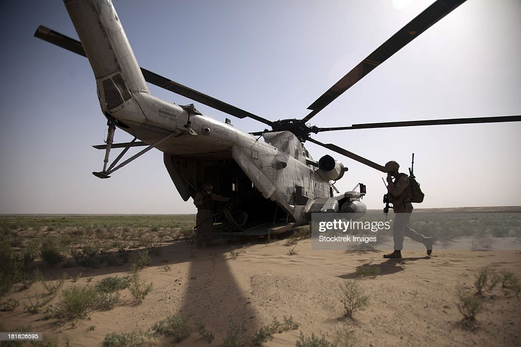 U.S. Marines board a CH-53D Sea Stallion helicopter in Afghanistan.