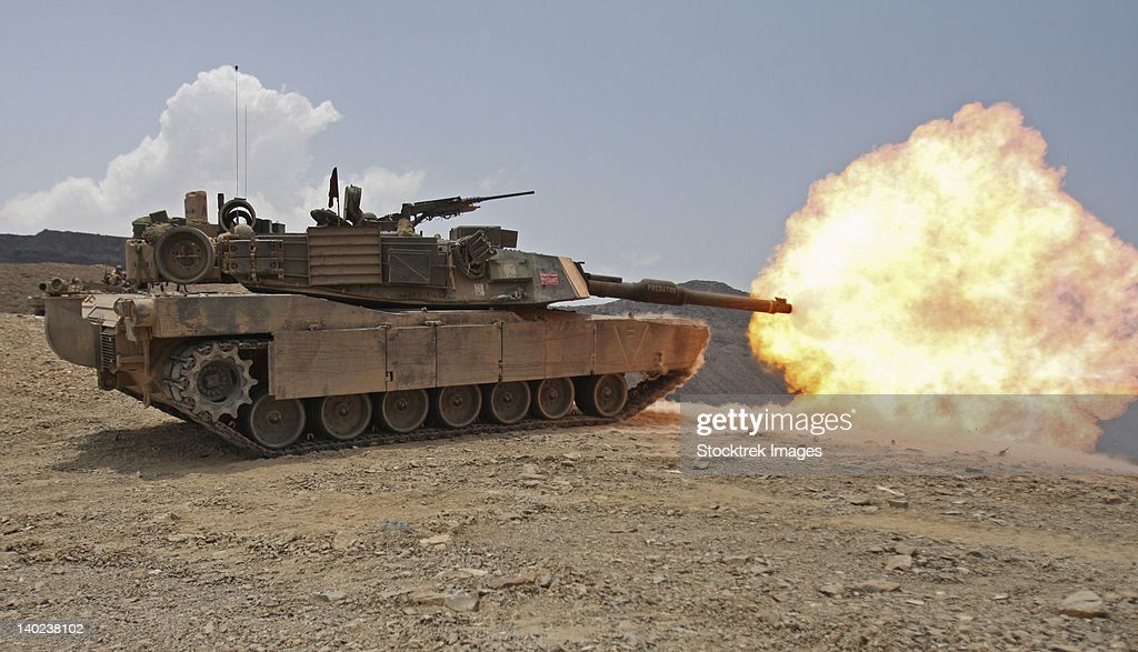 Marines bombard through a live fire range using M1A1 Abrams tanks.