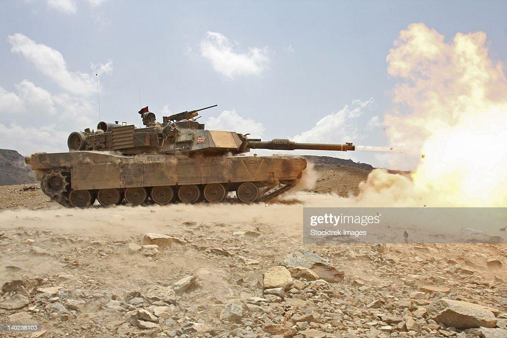 Marines bombard through a live fire range using M1A1 Abrams tanks.