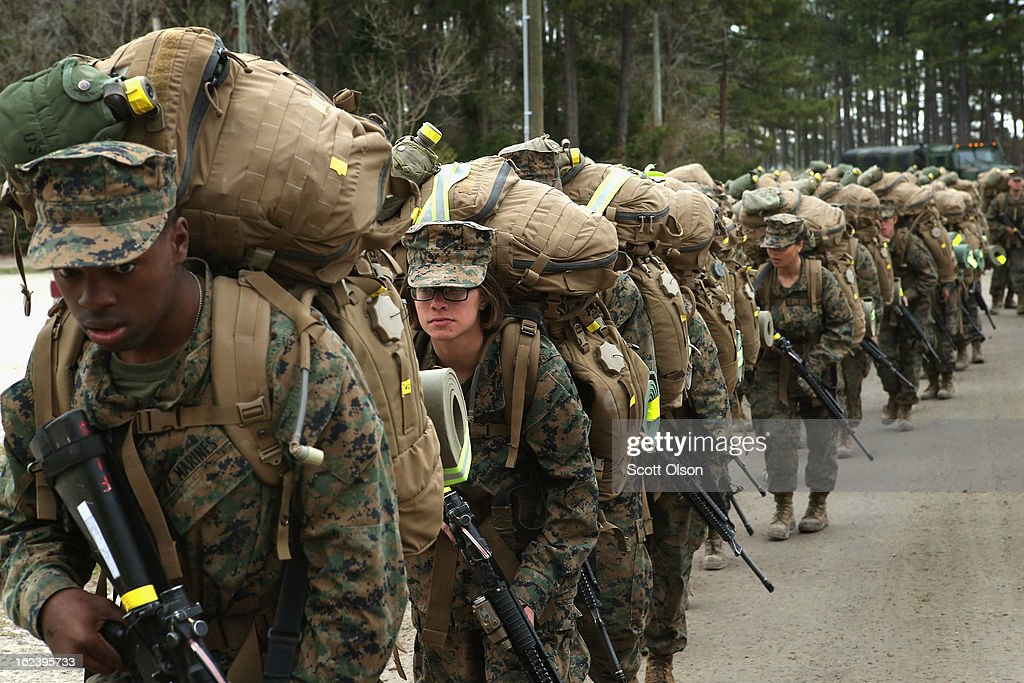 Marines, both male and female, participate in a 10 kilometer training march carrying 55 pound packs during Marine Combat Training (MCT) on February 22, 2013 at Camp Lejeune, North Carolina. Since 1988 all non-infantry enlisted male Marines have been required to complete 29 days of basic combat skills training at MCT after graduating from boot camp. MCT has been required for all enlisted female Marines since 1997. About six percent of enlisted Marines are female.