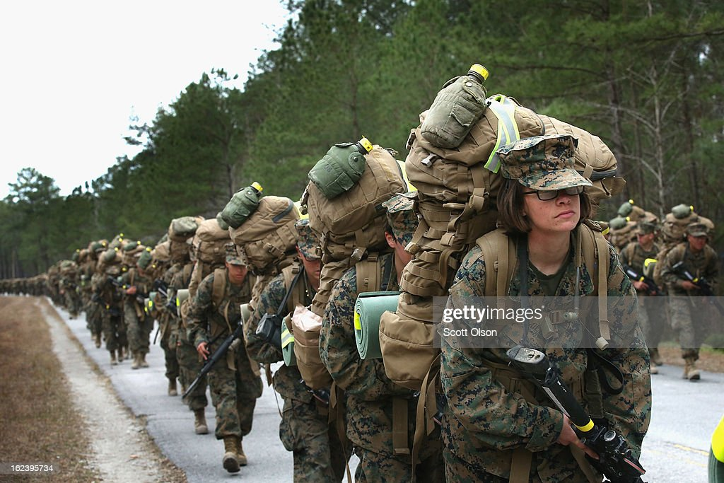 Marines both male and female participate in a 10 kilometer training march carrying 55 pound packs during Marine Combat Training on February 22 2013...