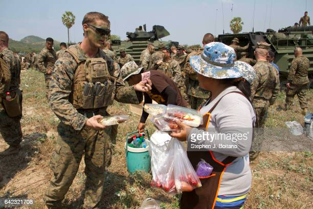 Marines buy food on the beach head during the USThai joint military exercise titled 'Cobra Gold' on Hat Yao beach in Chonburi province eastern...