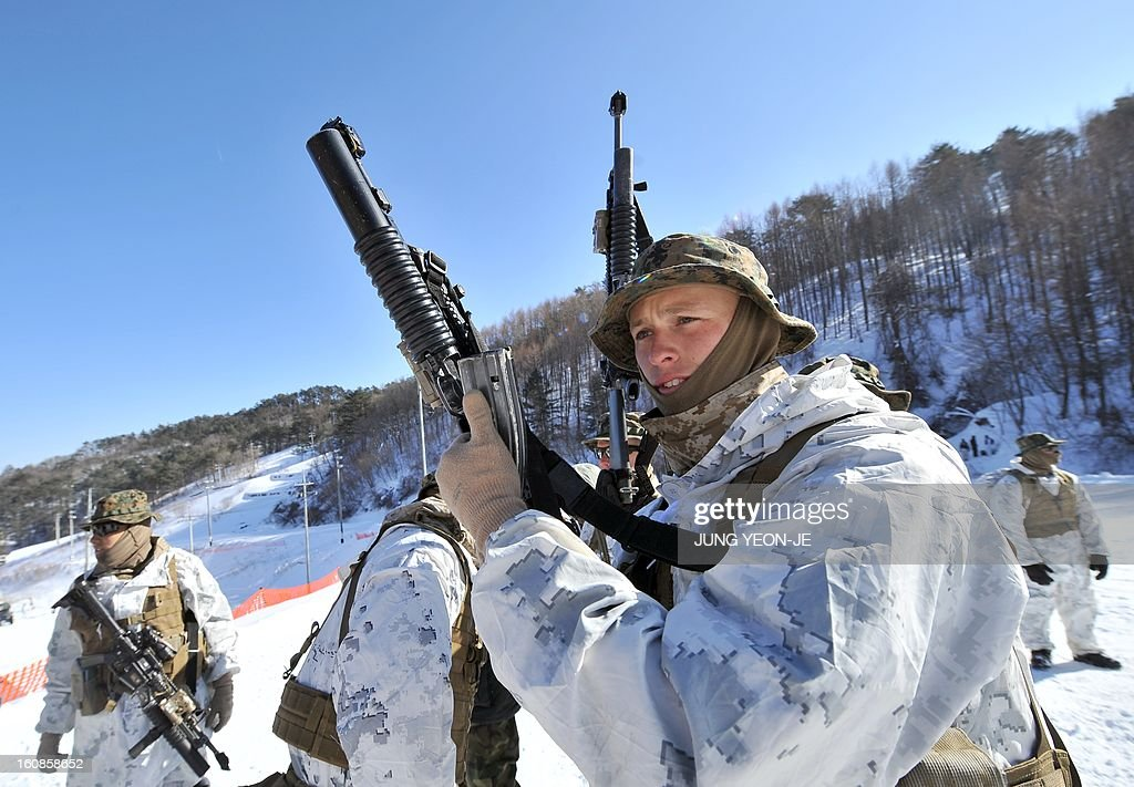 US Marines check their weapons during a joint winter drill in Pyeongchang, some 180 kilometers east of Seoul, on February 7, 2013. Marines from South Korea and the United States took part in a military winter drills, which began on February 4 and run through February 22, to test their limits in extreme conditions.