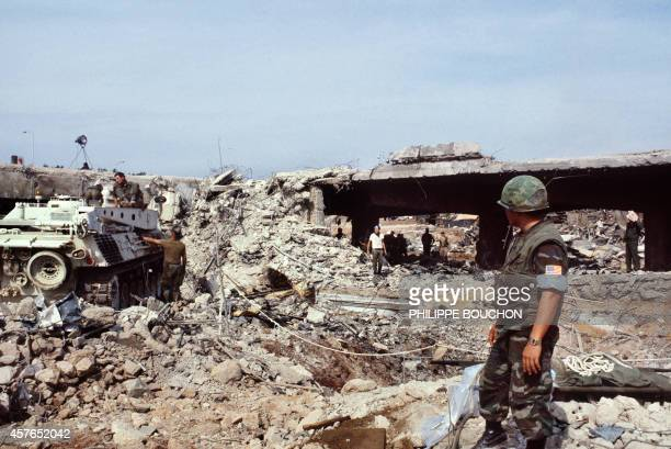 US marines continue to search for victims on October 31 after a terrorist attack against the headquarters of the US troops of the multinational force...