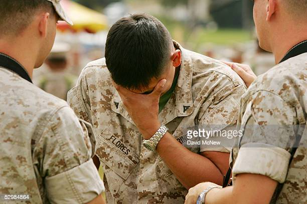 S Marines Corp Thomas Hudzinski and Corp Andrew Young comfort fellow photographer Lance Corp Ben Flores who grieves after paying his respects at a...