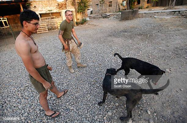 Marines Cpl Jonathan Eckert of Oak Lawn IL and Cpl Mathew Baker of Lee Center NY attached to India Battery 3rd Battalion 12th Marine Regiment watch...