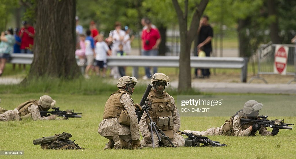 US marines demonstrate security procedures as the US Marines conduct a public helicopter demonstration May 28, 2010 at Orchard Beach, Bronx, NY. The event was one of many held this week as New York City celebrates Fleet Week.