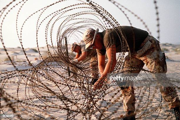 S Marines deploy concertina wire to prevent infiltration of their encampment during Operation Desert Shield