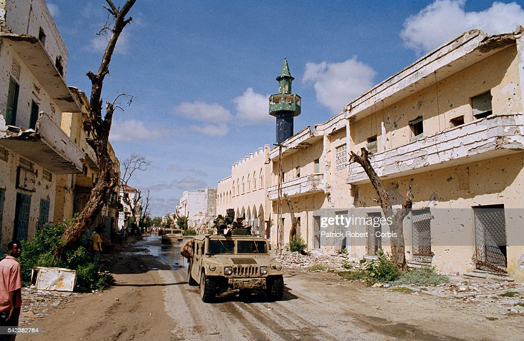 US Marines drive past damaged buildings while stationed in Somalia for Operation Restore Hope the codeword for the American military mission...