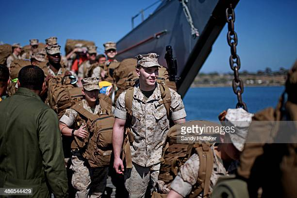 Marines exit a LCU boat during a homecoming at Del Mar Beach on April 24 2014 in Camp Pendleton California Approximately 2400 Marines from the 13th...