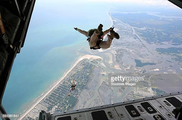 U.S. Marines exit the ramp of a C-130 aircraft over North Carolina.