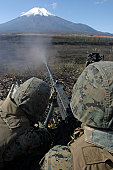 November 4, 2009 - Marines fire an M2 .50 caliber machine gun during a crew-served weapons shoot at North Fuji Maneuver Area, Camp Fuji, Japan. Marines and sailors from the battalion sharpened their a