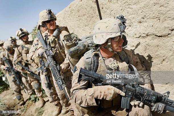 S Marines from 2nd Marine Expeditionary Brigade RCT 2nd Battalion 8th Marines Echo Co prepare to search a building during the start of Operation...