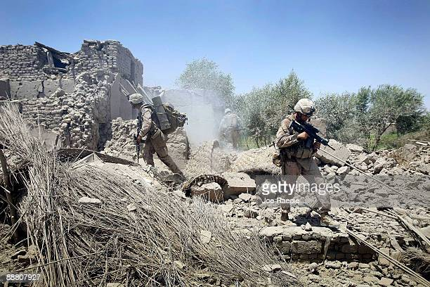 S Marines from 2nd Marine Expeditionary Brigade RCT 2nd Battalion 8th Marines Echo Co check what is left of a compound that was hit with a 500 lb...