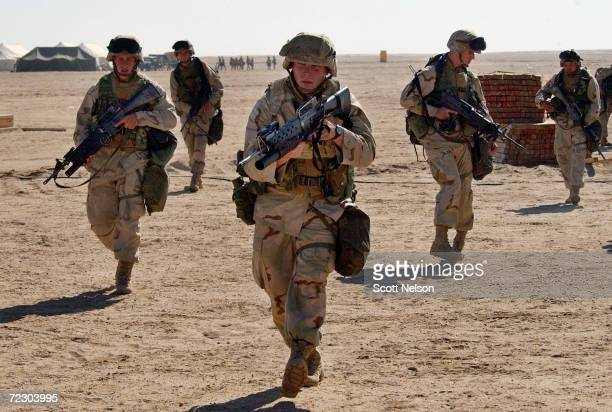 S Marines from 3rd Battallion 1st Marine Division practice squad rushes February 1 2003 at Living Support Area 7 near the Iraqi border in northern...