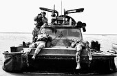 Marines from 539 Assault Squadron rest on a hovercraft on the Al Faw penninsula Iraq Under cover of darkness on March 21 539 Assault Squadron Royal...