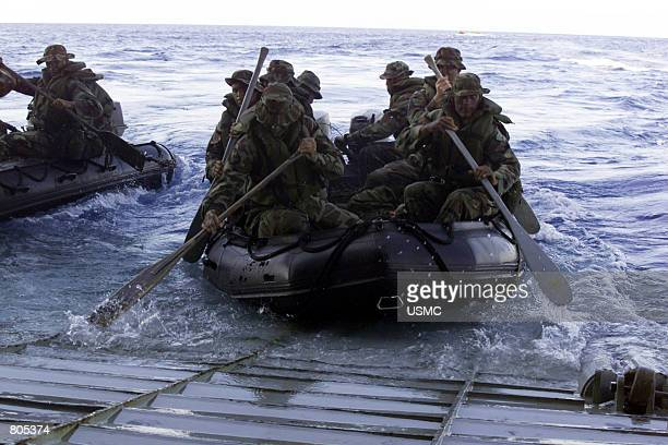 Marines from Battalion Landing Team 2/2's Golf Company launch their Combat Rubber Reconnaissance Crafts September 26 2000 from the well deck of USS...