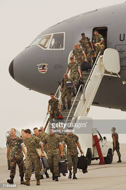 S Marines from Helicopter Squadron 466 'Wolfpack' depart a plane for a homecoming July 22 2003 at Miramar Marine Corps Air Station in San Diego...