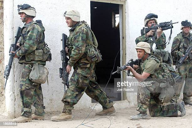 S Marines from Task Force Tarawa attack the military garrison of the Iraqi 23 Infantry brigade March 24 2003 in the southern Iraqi city of Nasiriyah...