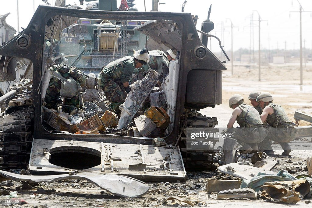war against continues pictures getty images war against continues u s marines from task force tarawa search an armored attack vehicle for body parts and other