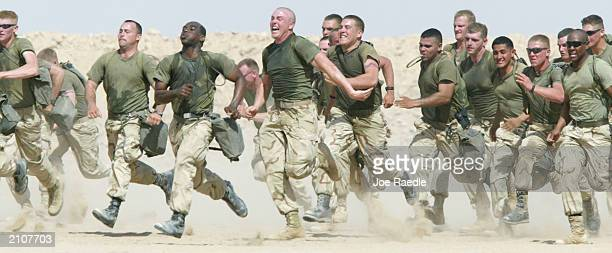 US Marines from Task Force Tarawa take part in a 25 mile run March 16 2003 at Camp Shoup near the Iraqi border in Kuwait 1/2 Charlie Company returned...