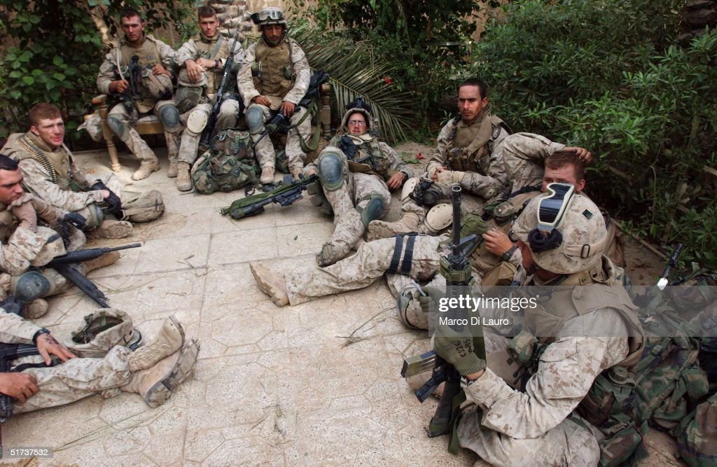 U.S. Marines from the 1st U.S. Marines Expeditionary Force, 1st Battalion, 3rd Marines Regiment, Charlie Company, rest during the offensive November 13, 2004 in Fallujah, Iraq. According to Iraqi National Security Adviser Kasim Dawood, 1000 insurgents have been killed and 200 insurgents have been captured during the six-day battle. U.S. Marines have been arresting males between the combat age of 15 and 55-years-old.