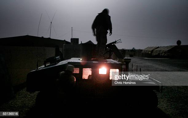 Marines from the 3rd Battalion 4th Marines arrive back at base after a midnight patrol around Camp Mercury the former Camp Abu Ghraib June 23 2005 in...