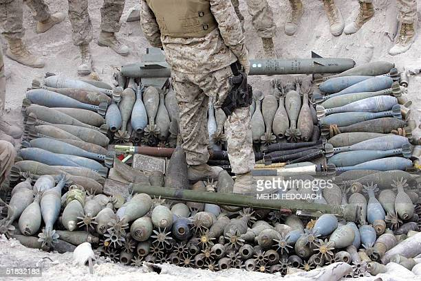 US marines gather ammunition found in Fallujah to be detonated in the restive city 50 kms west of Baghdad 06 December 2004 Almost 1000 US military...