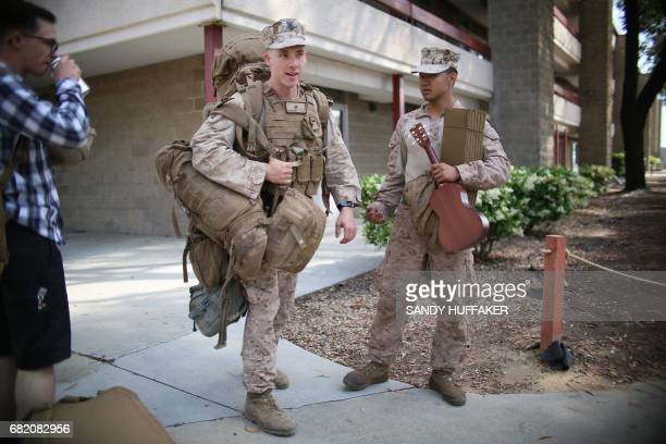 Marines gather their belongings after a homecoming reception at Camp Pendleton in Oceanside California on May 11 2017 Marines and sailors from the...