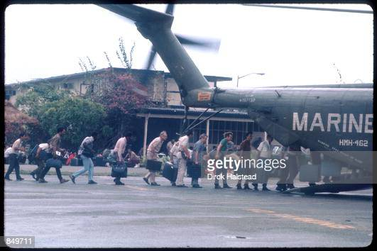 S Marines guard the evacuation of civilians at Tan Son Nhut airbase in Vietnam while under Viet Cong fire during the fall of Saigon April 15 1975