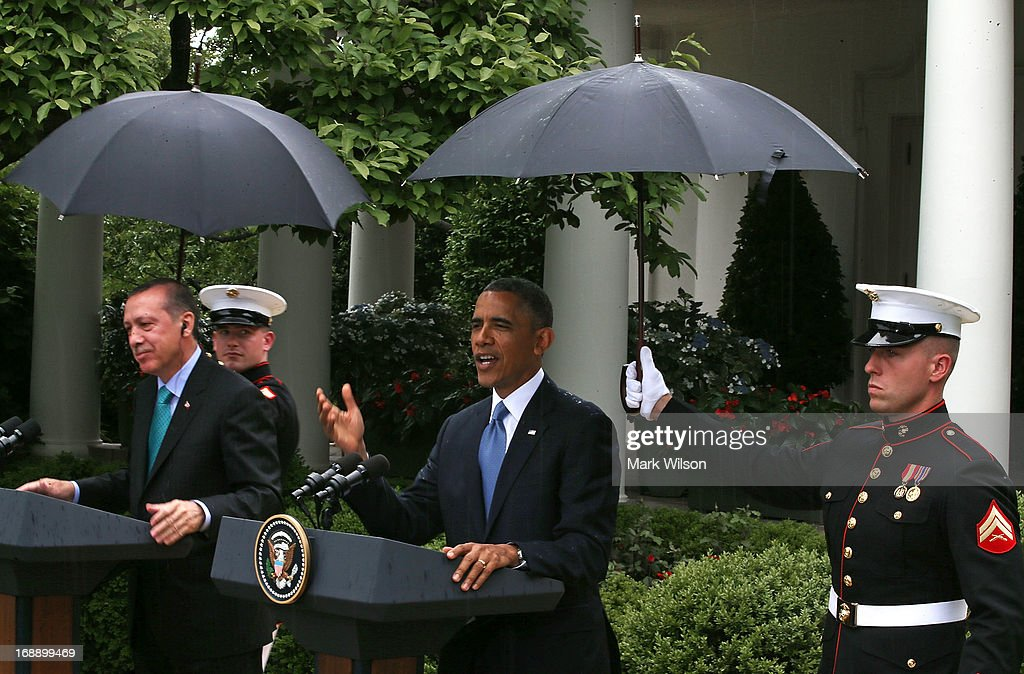 U.S. Marines hold umbrellas over U.S. President <a gi-track='captionPersonalityLinkClicked' href=/galleries/search?phrase=Barack+Obama&family=editorial&specificpeople=203260 ng-click='$event.stopPropagation()'>Barack Obama</a> (R) and Prime Minister <a gi-track='captionPersonalityLinkClicked' href=/galleries/search?phrase=Recep+Tayyip+Erdogan&family=editorial&specificpeople=213890 ng-click='$event.stopPropagation()'>Recep Tayyip Erdogan</a> of Turkey as they speak to the media in the Rose Garden at the White House May 16, 2013 in Washington, DC. The two leaders spoke about the fighting in Syria, and President Obama answered questions on the IRS Justice Department invesigation.