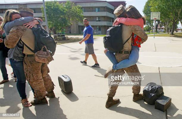 Marines hug their loved ones upon return during a homecoming reception at Camp Pendleton in Oceanside California on May 11 2017 Marines and sailors...