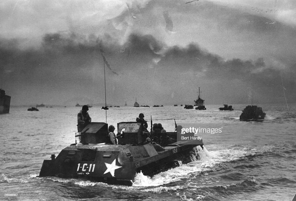 US Marines in amphibious assault craft moving towards Inchon in the first counterattack of the Korean War during a heavy bombardment of coastal...