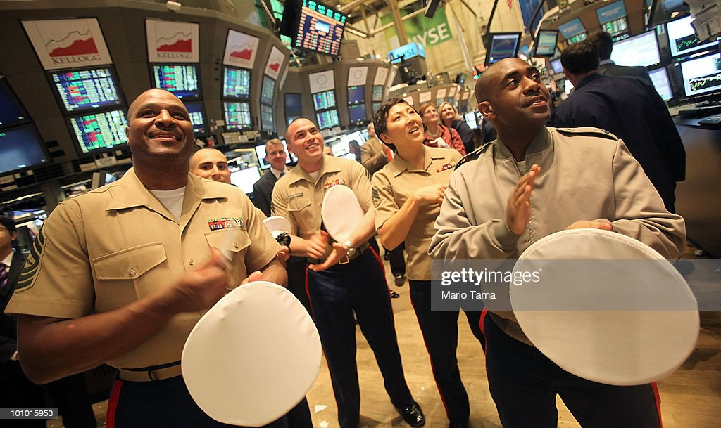 U.S. Marines in the city for Fleet Week applaud during the closing bell on the floor of the New York Stock Exchange May 27, 2010 in New York City. The Dow finished up 284 points to close at 10258.99 led by energy, technology and financial stocks.