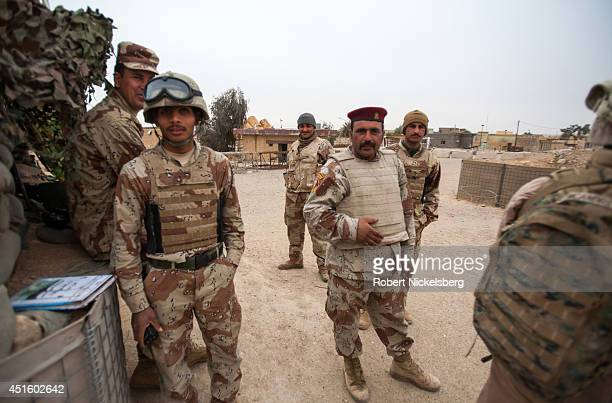 S Marines left interact with Iraqi Army soldiers February 17 2007 near the Syrian border in Husayba Iraq Husayba a strategic border crossing with...