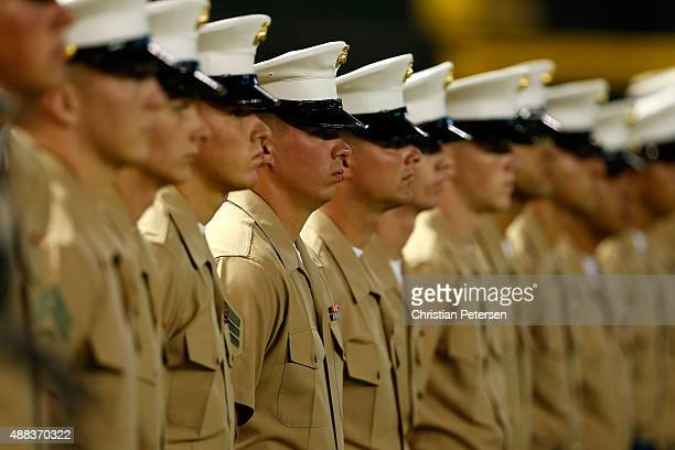Marines line up on the field in honor of Marine week before the MLB game between the Arizona Diamondbacks and the Los Angeles Dodgers at Chase Field...