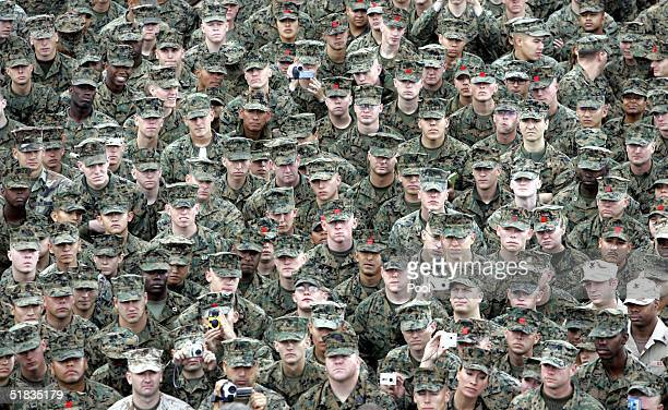 S Marines listen to US President George W Bush speak during a visit to Camp Pendleton December 7 2004 in California President Bush thanked the...