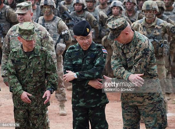 US Marines Lt General David Berger Chief of the Royal Thai armed forces General Surapong SuwanaAdth and Japanese Lt General Sumida look to cross...