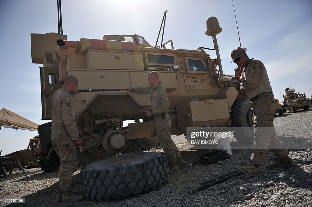 US Marines Master Gunnery Sergeant Victor Purvis Maintenance Officer 3rd Light Armored Reconaissance Battalion 2nd Marine Division inspects Lance...