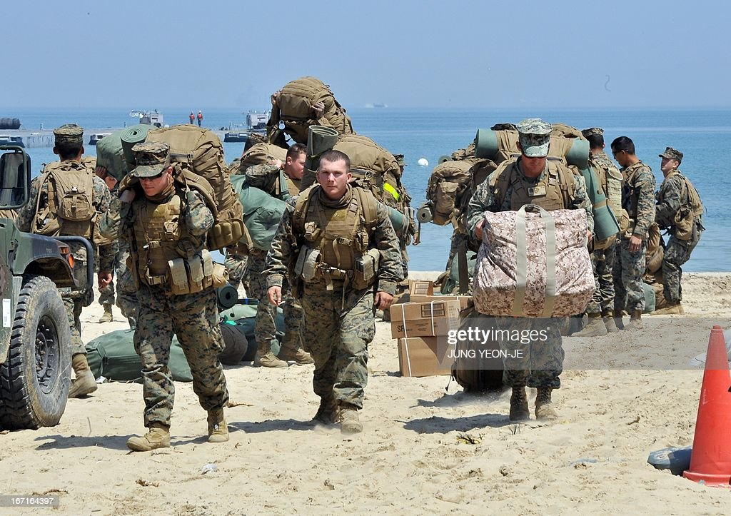 US Marines move across a beach during the Combined Joint Logistics Over the Shore (CJLOTS) exercise in Pohang, 260 kms southeast of Seoul, on April 22, 2013. The wait for North Korea's expected missile test, which has kept South Korean and US forces on heightened alert for the past two weeks, may stretch to July, the South's defence ministry said on April 22.