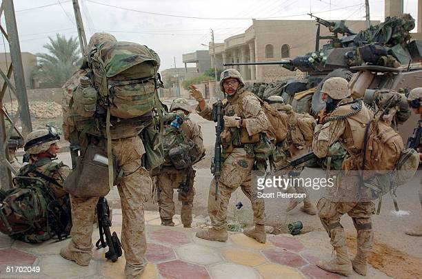 Marines of Bravo Company 1st Battalion 3rd Marines make try to clear a street November 9 2004 in Fallujah Iraq On the authority of Interim Prime...