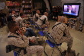 US Marines of Regiment Combat Team 1 watch TV as President Barack Obama announces the death of Osama Bin Laden at Camp Dwyer in Helman Province on...
