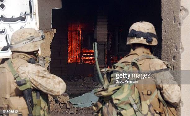 Marines of the 1st Battalion 3rd Marines battle with three insurgents while searching a house leaving three insurgents one marine dead and marines...