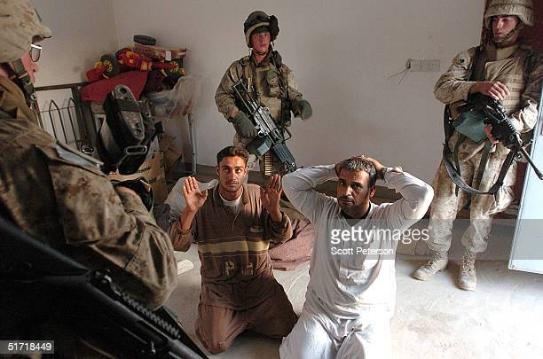 S Marines of the 1st Light Armored Reconnaissance company part of 1st Battalion 3rd Marines find two men as they search houses for insurgents...