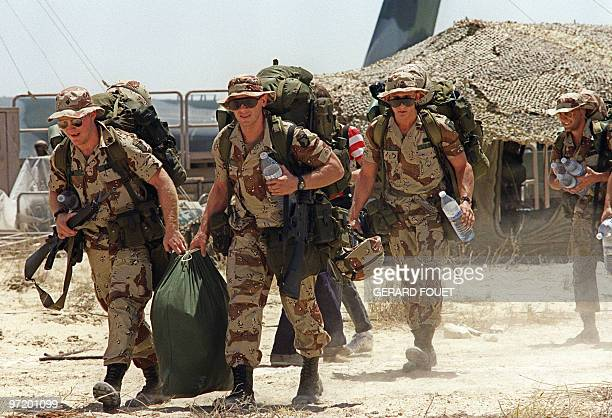 US Marines of the 782 company from Fort Bragg South Carolina walk 21 August 1990 towards their barracks upon landing at Saudi Dhahran air base Iraq's...
