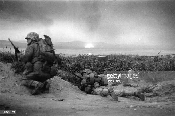 US Marines of the UN invasion force which landed at Inchon in South Korea advance inland during the Korean War Original Publication Picture Post 5086...
