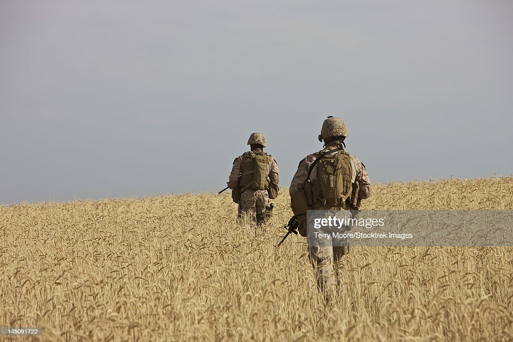 U.S. Marines patrol a wadi near Kunduz, Afghanistan clearing it for a range exercise.