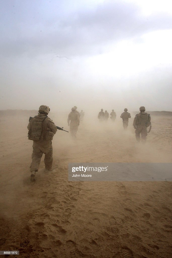 U.S. Marines patrol through a sand storm on March 22, 2009 in remote Qalanderabad in southwest Afghanistan. The Marines, from India company of the 3rd Battalion, 8th Marine Regiment are bracing for increased Taliban attacks with the onset of the spring 'fighting season.'