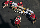 March 26, 2011 - Marines assigned to the aircraft carrier USS Enterprise (CVN-65) push ordnance into place to arm an F/A-18C Hornet while underway in the Arabian Sea.  The Enterprise and Carrier Air W