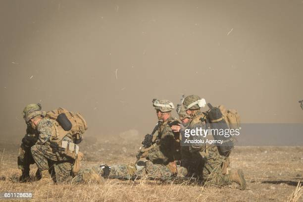 Marines rescue an injured person in a simulated training during a joint training drill with Japan Maritime Self Defense Force's in Camp Soumagahara...